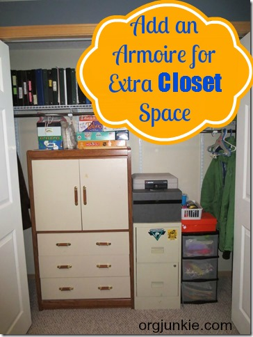 add an armoire to your closet for extra storage space