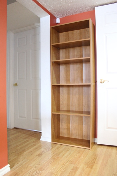 corner with empty bookcase