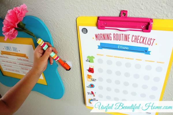Sticking-the-dry-erase-marker-next-to-the-kiddie-checklist