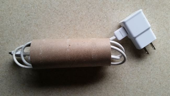 Use a toilet paper roll for cords